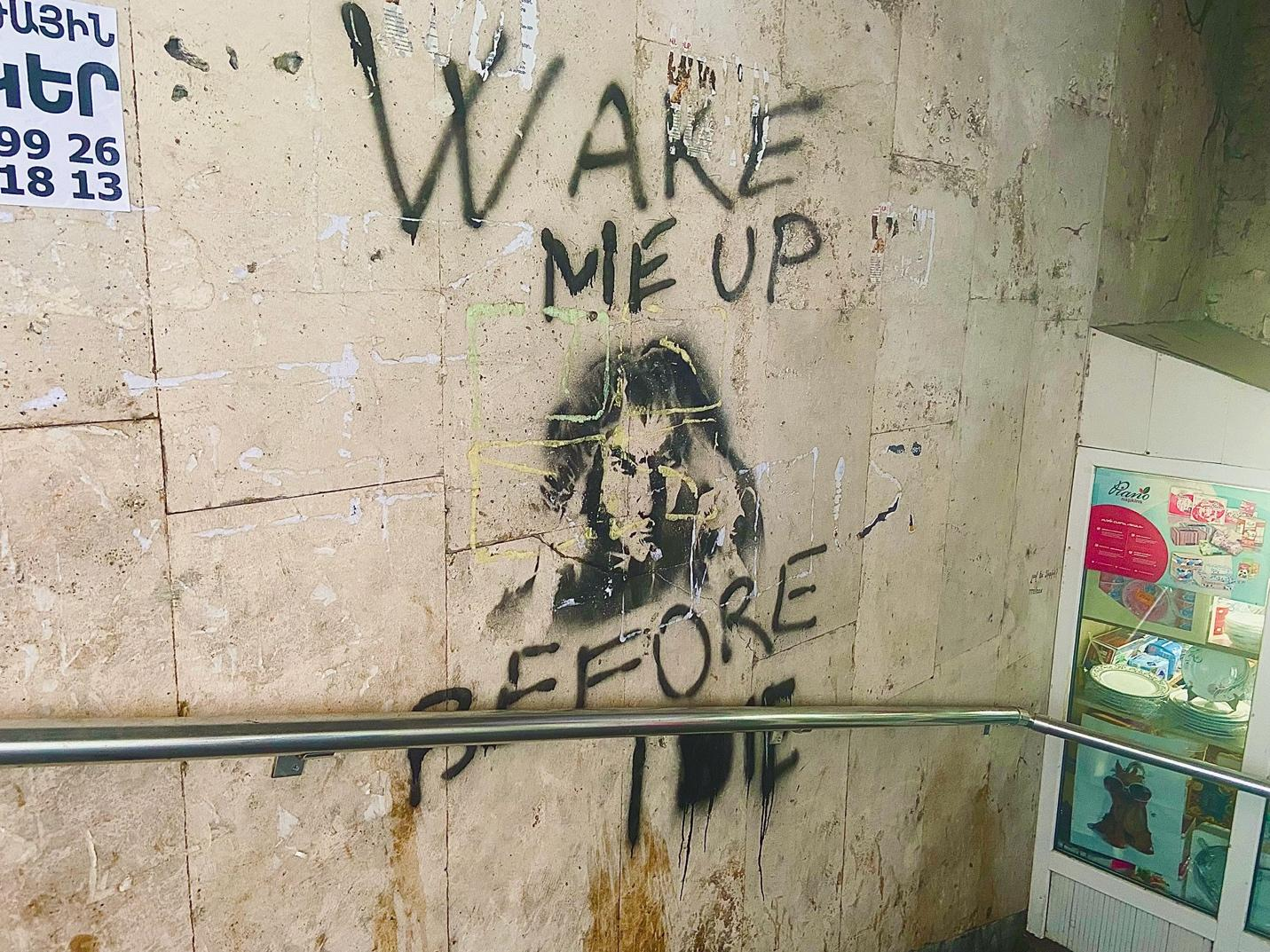A picture containing text, graffiti, dirty Description automatically generated