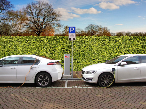 Two EVs charging ahead of the 2030 electric switchover.