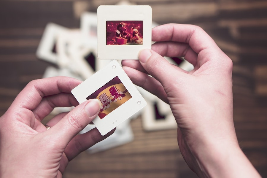 Photograph of hands holding two polaroid photos