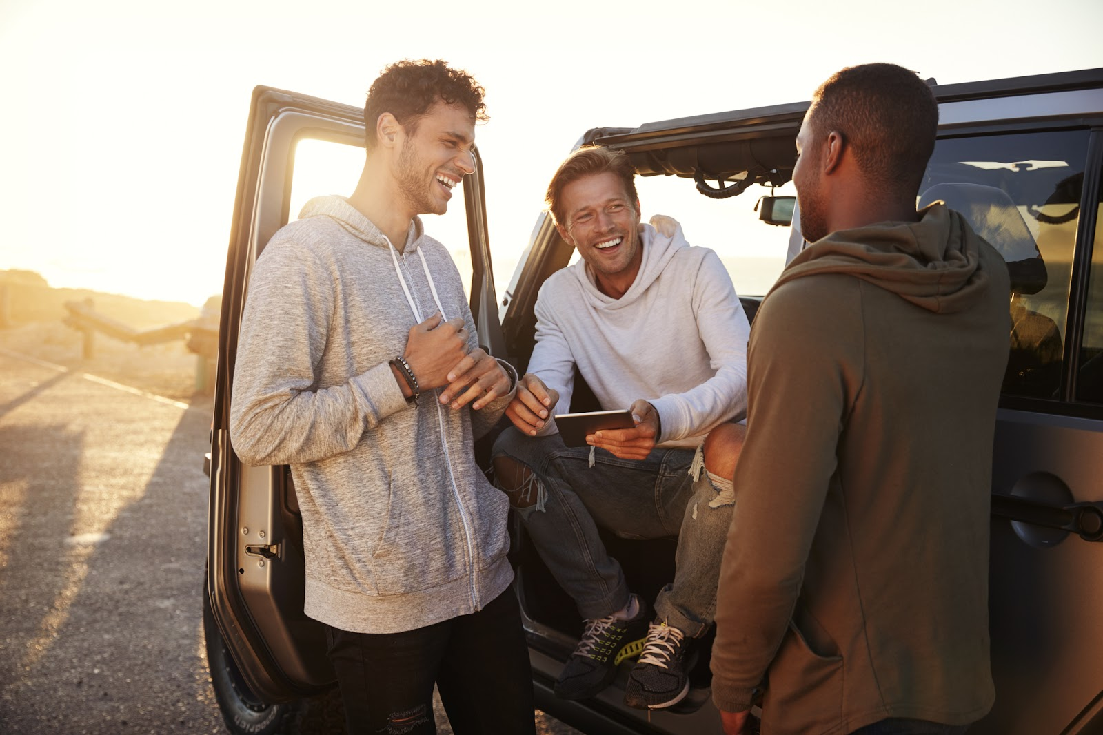 What can skew a PSA test: Three men talking by a car