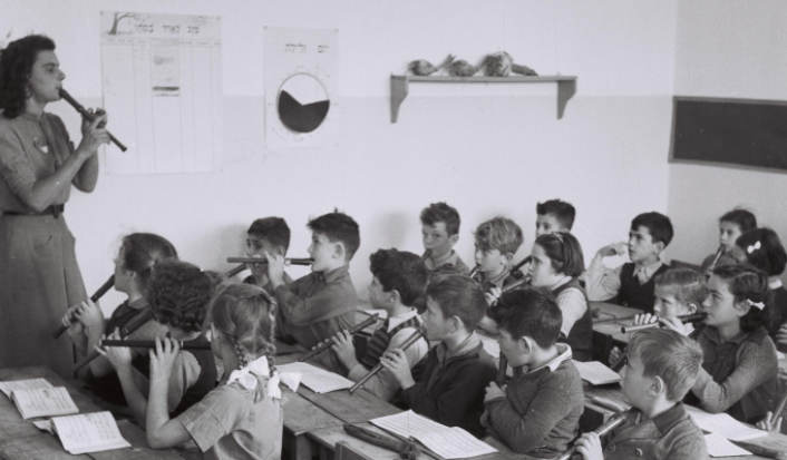 Teacher and students in recorder class