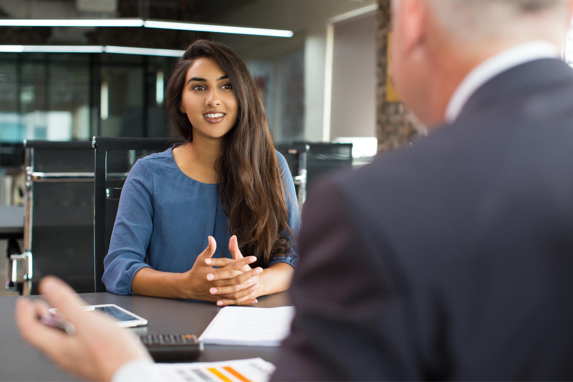 A Human Resources Manager interviewing a person for a job.