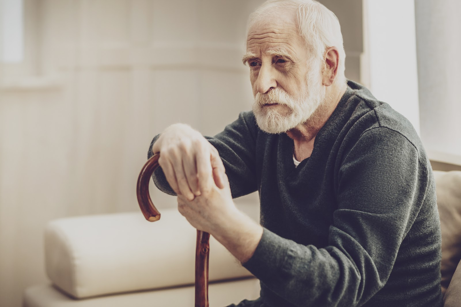 An elderly man lost in thought