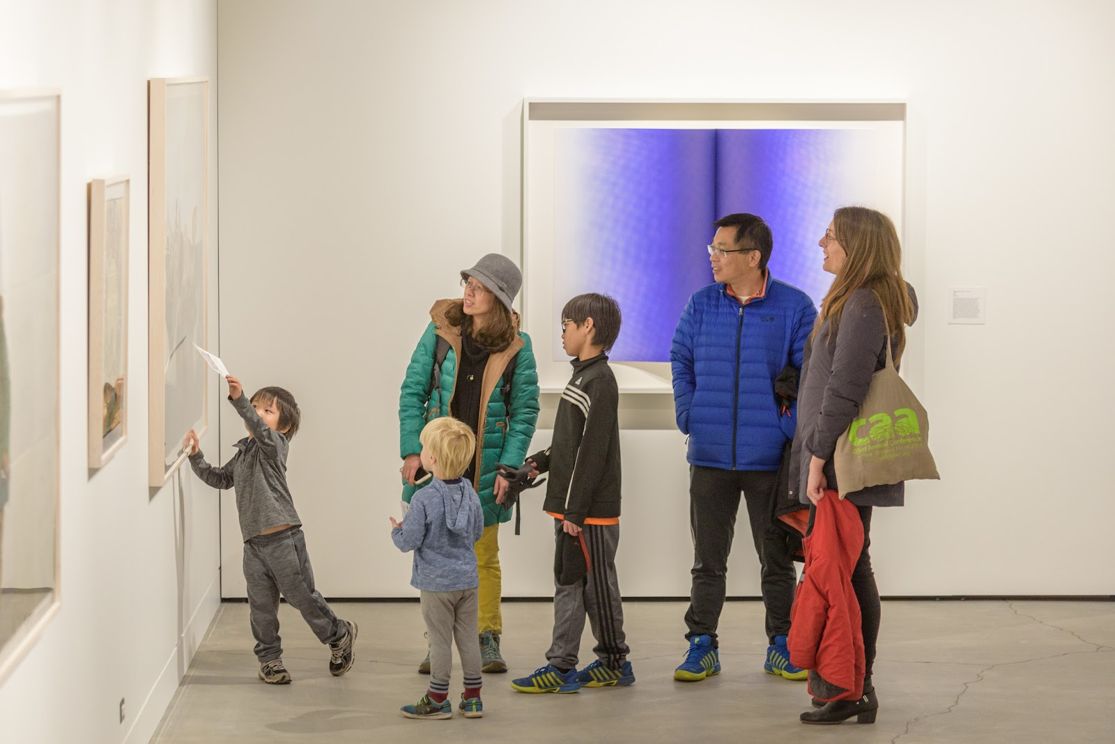 A family views an art piece in an art museum