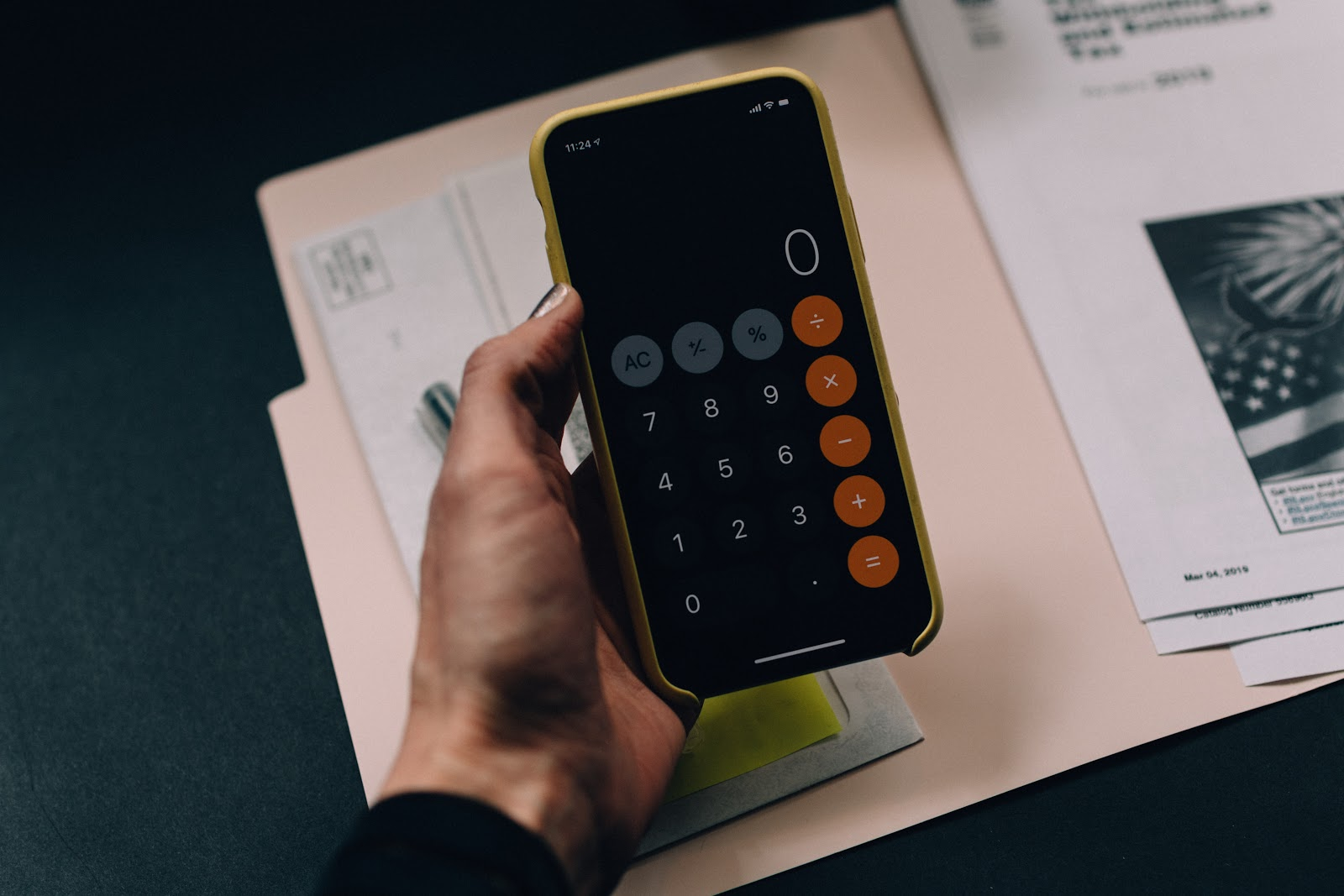 A person looking at the mobile calculator app