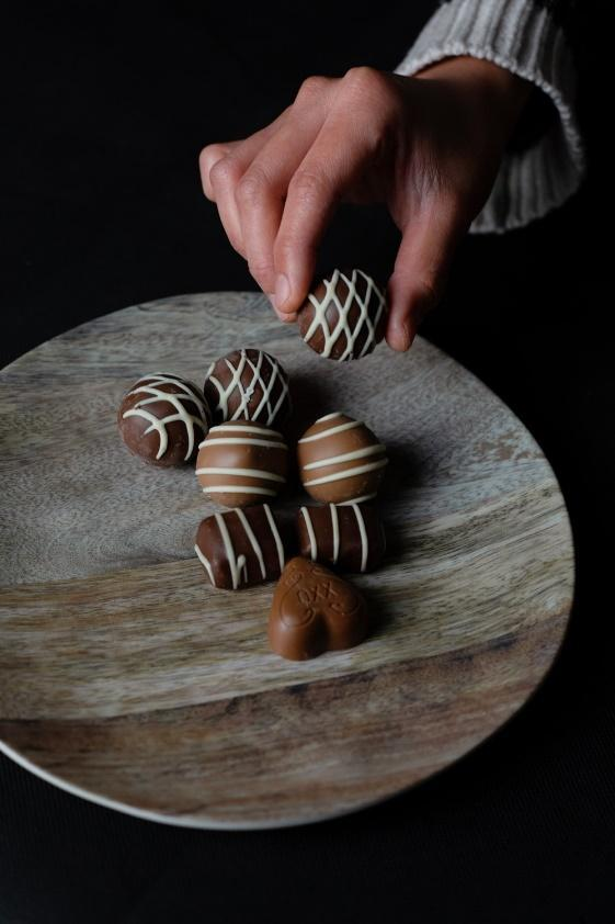 person holding chocolate ball