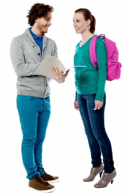 young man holding notebook and young woman carrying backpack