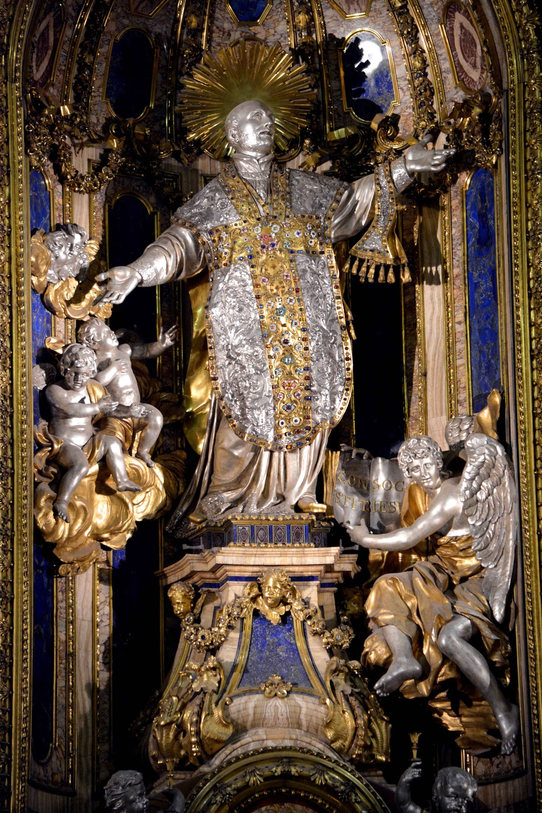 Statue of Ignatius of Loyola covered in gilding and decorations.