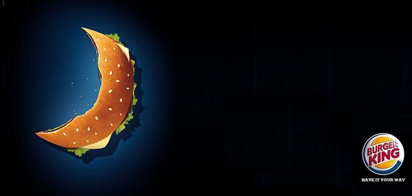 The image shows how Burger King has adapted to the Muslim culture and created its advertisement in Ramadan style by showing a mostly eaten burger, presented in the shape of a crescent moon.  Source - islamicity
