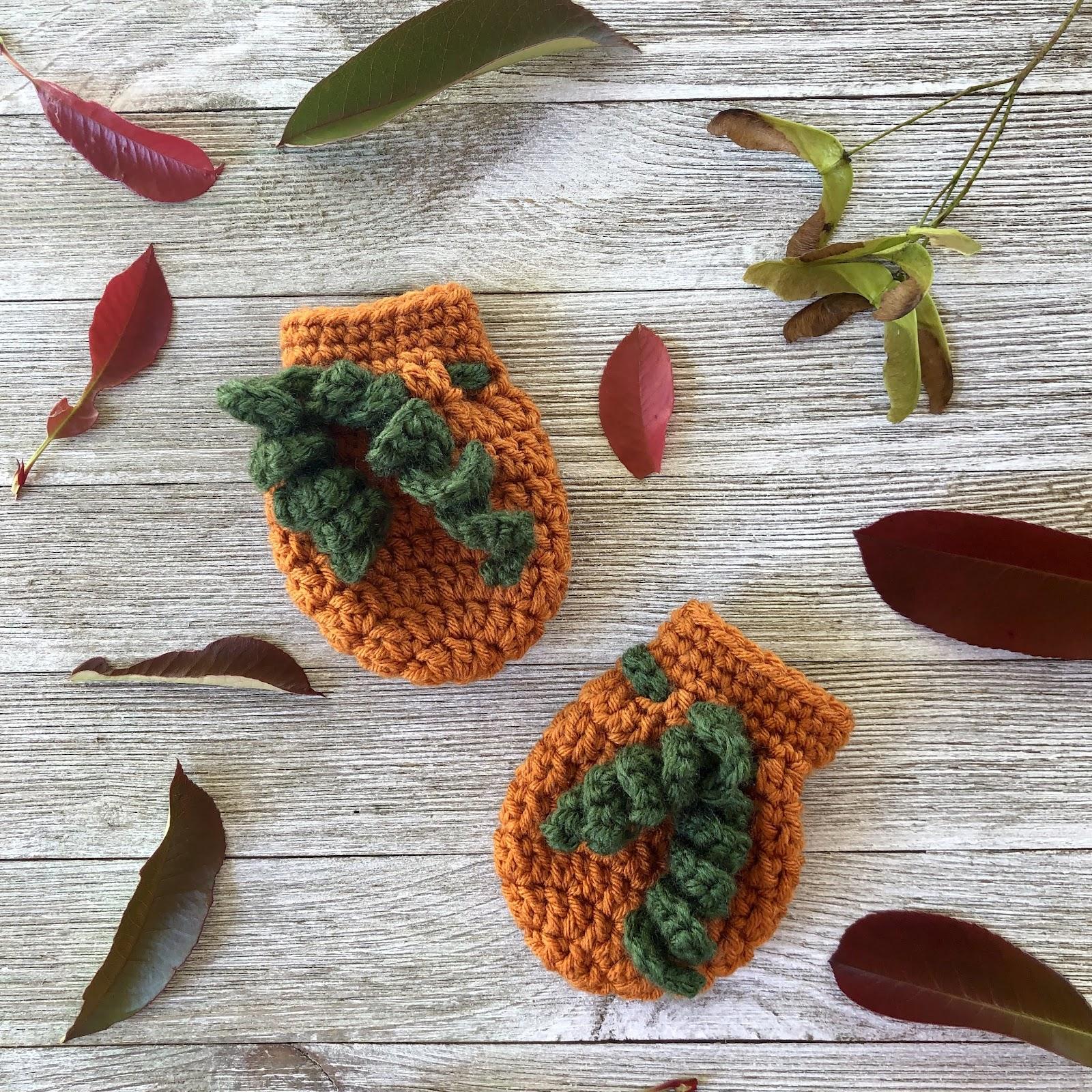 Crochet pumpkin baby mittens pattern by www.itchinforsomestitchin.com