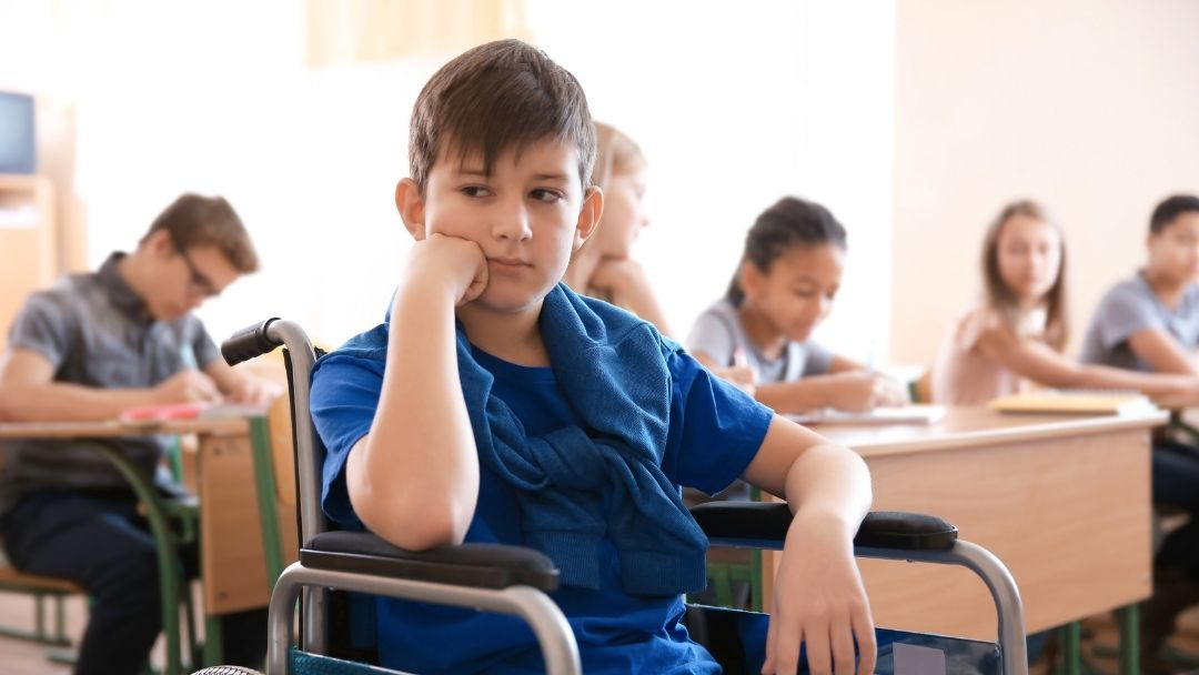 boy in wheelchair upset at school