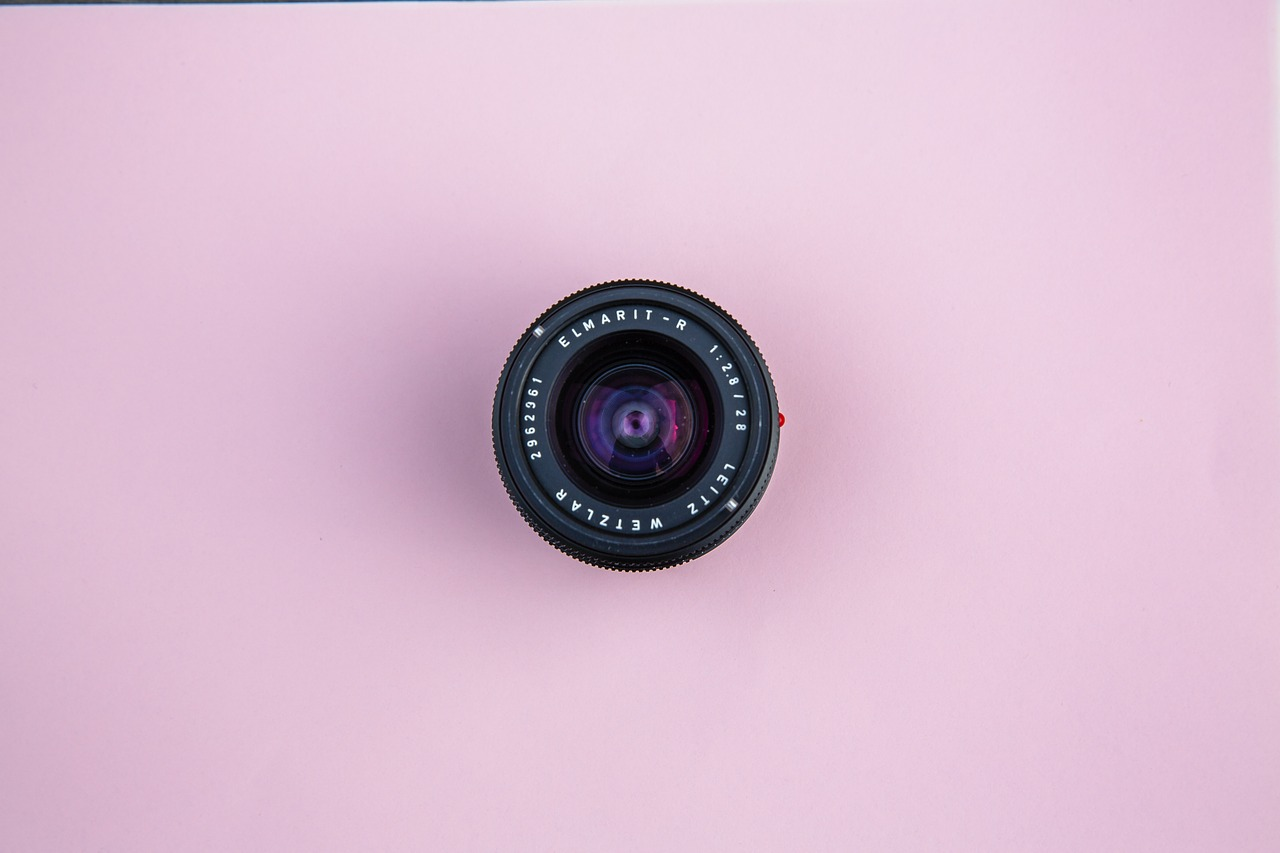 camera lens on pink background