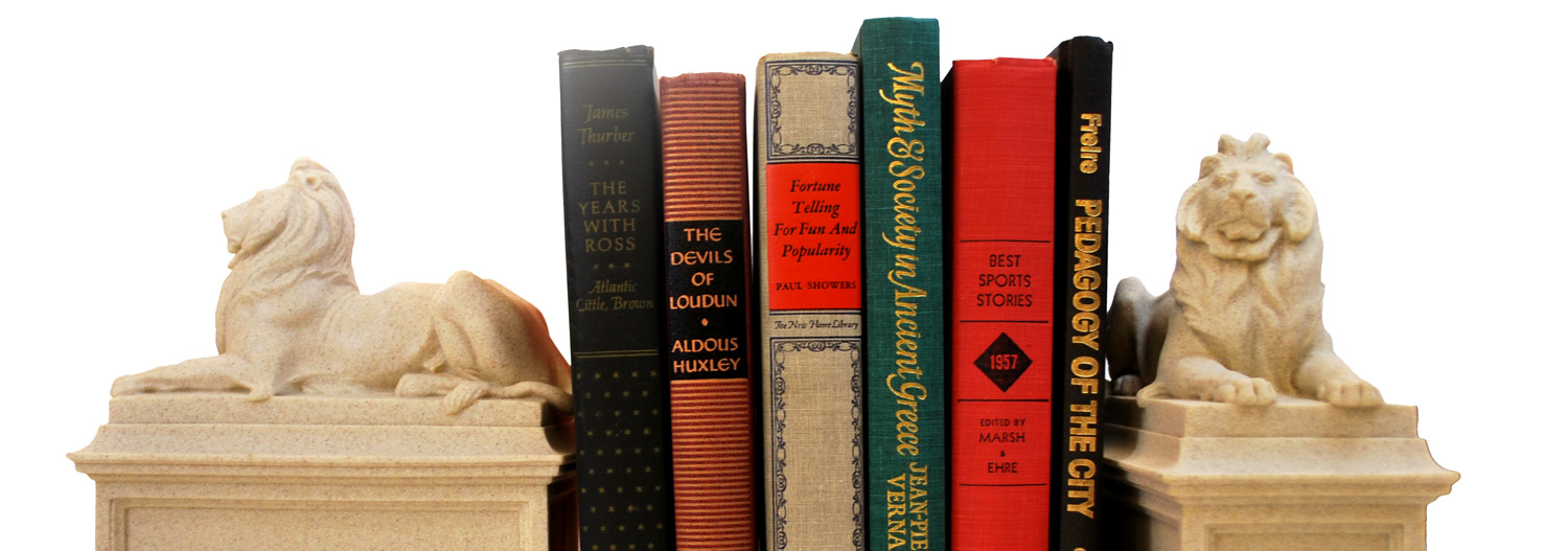 Five books in between marble-looking bookends of the New York Public Library lions