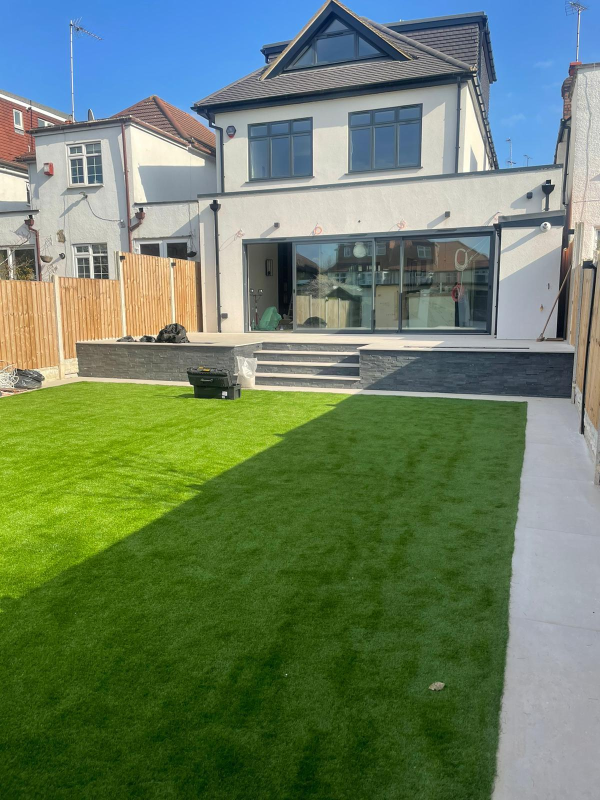 A picture containing grass, outdoor, building, sky  Description automatically generated