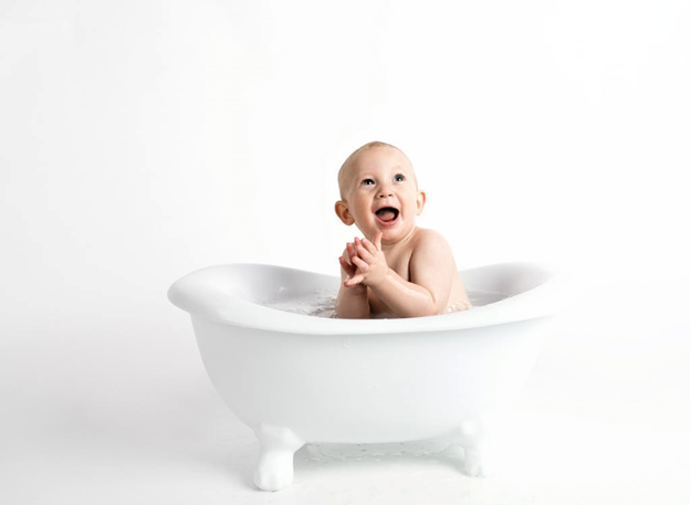 baby in a bath tub