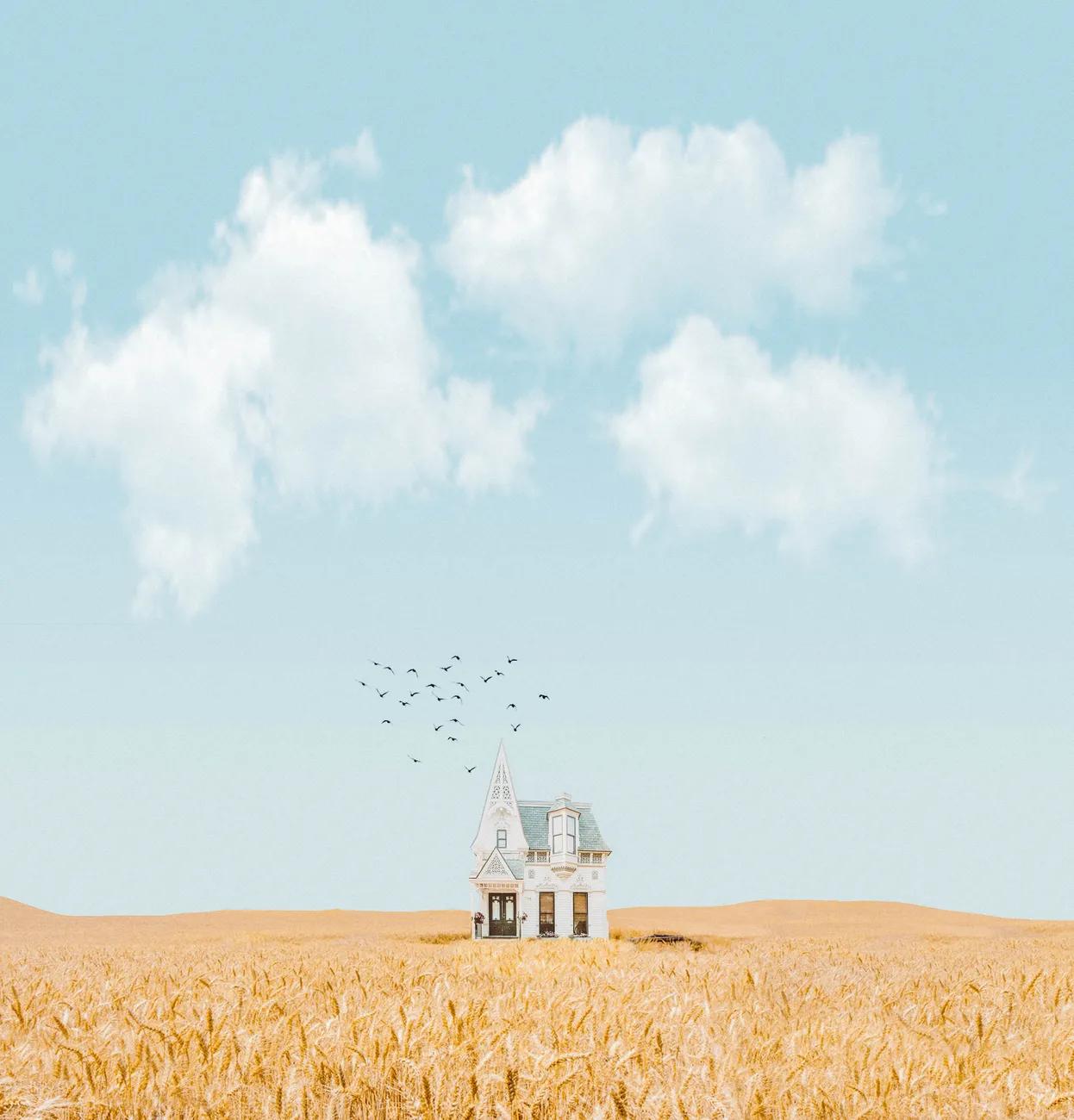 vast sky scene with house