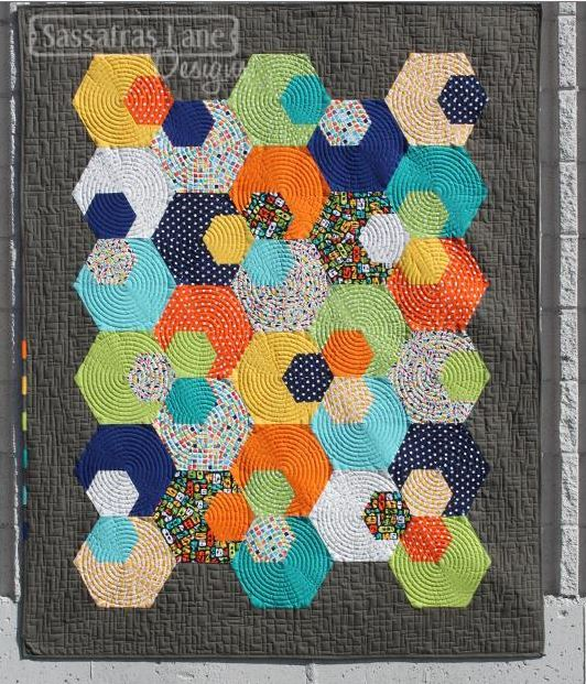 Quilt with Layered Multi-Colored Hexagons
