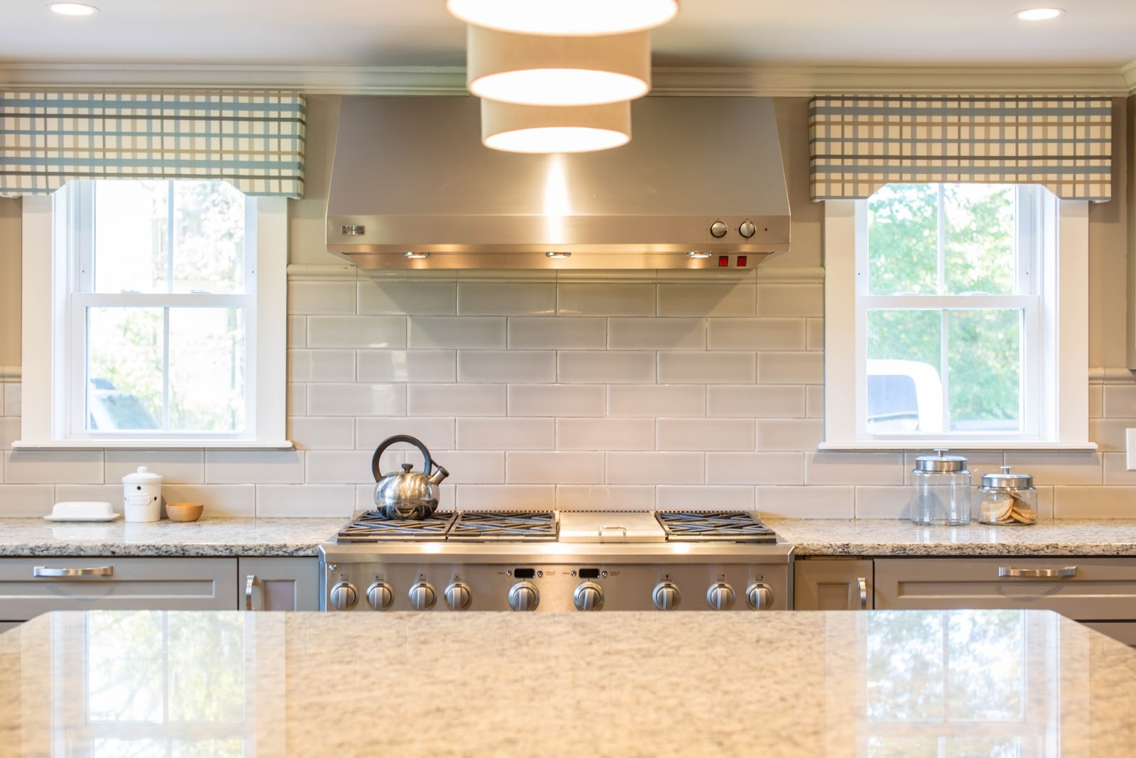 Integrate natural elements in your kitchen using natural stone and throwing the windows open to invite natural light.