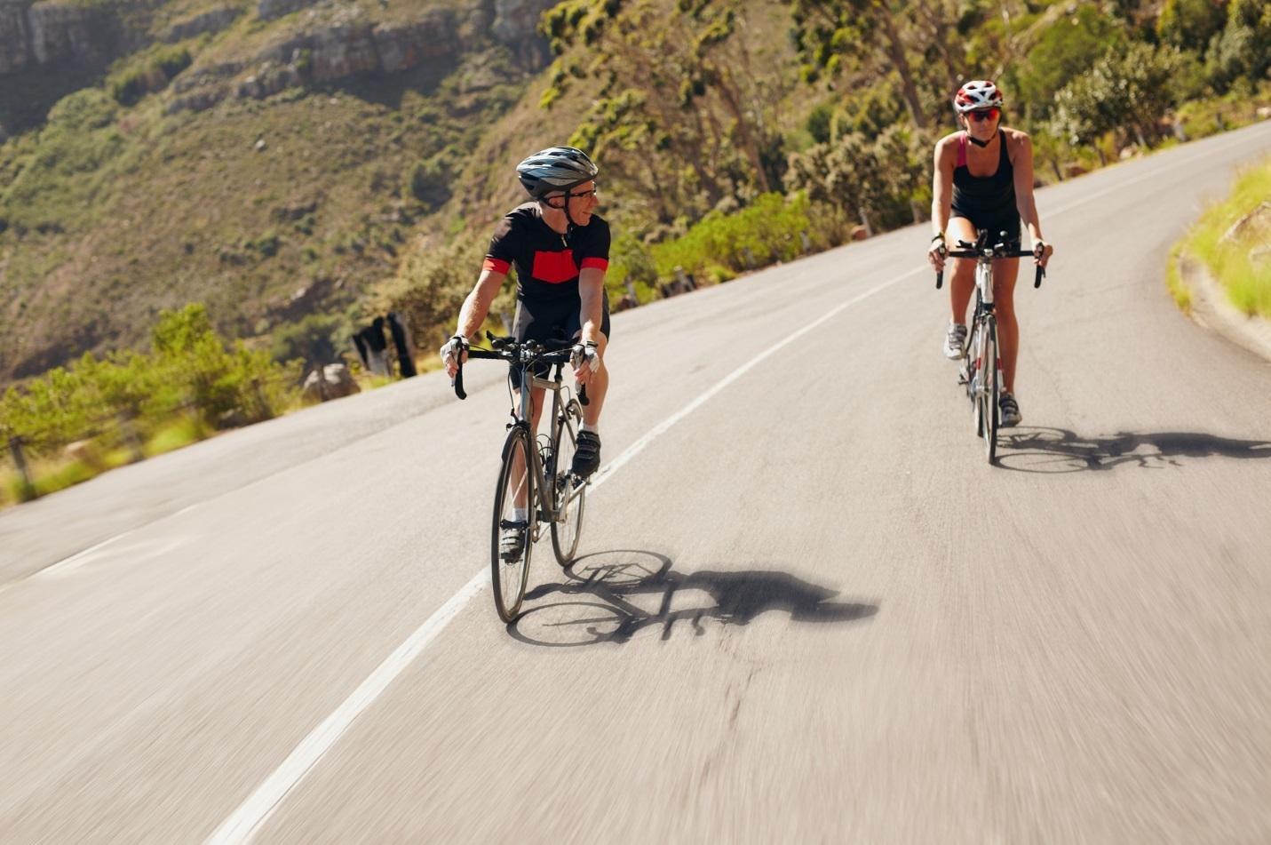 C:UsersivlevDownloadstwo-cyclist-practicing-for-triathlon-race-PQY9VFV.jpg