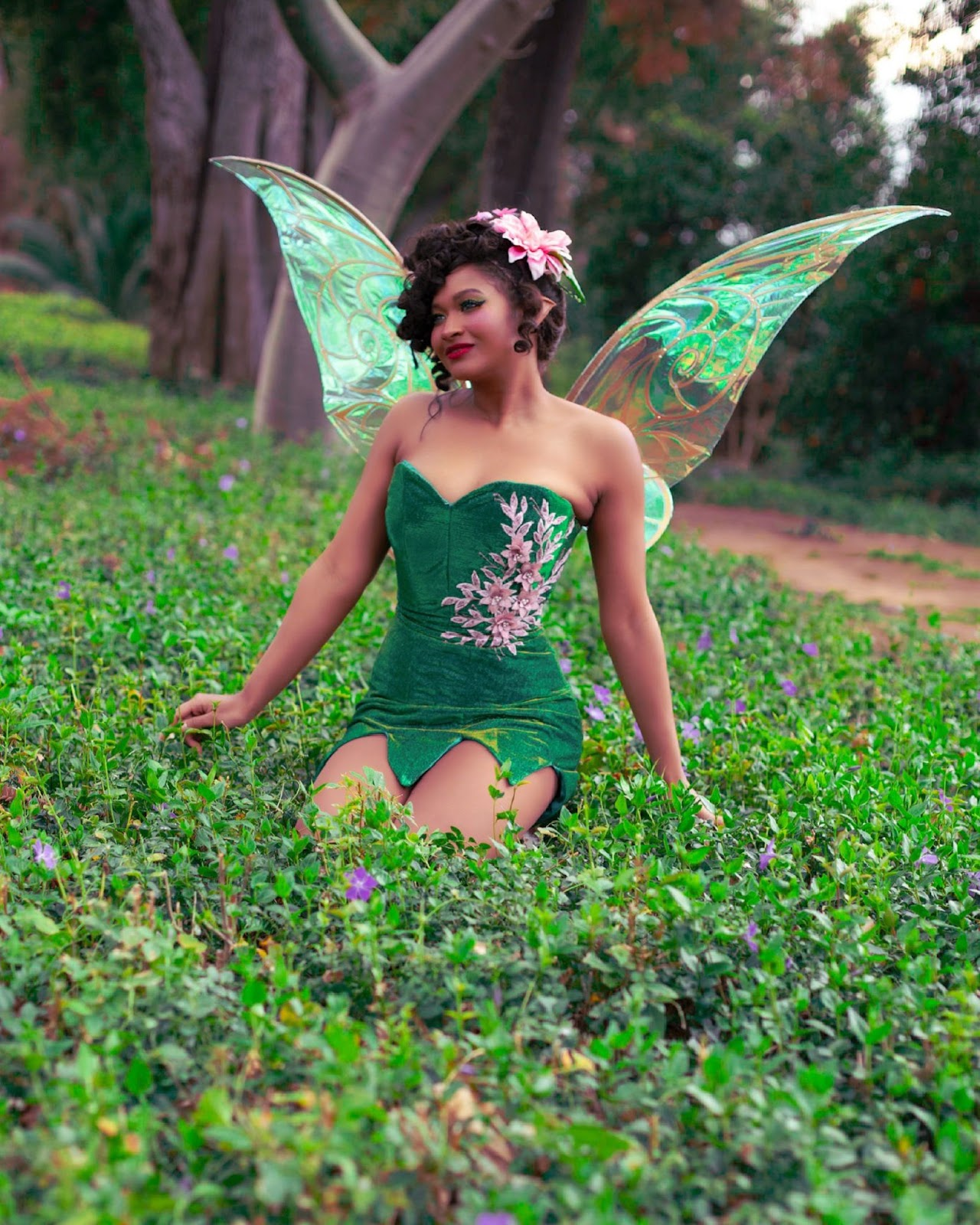 tinker bell cosplay from peter pan and tinker bell. green dress, fluorescent wings, lily pad head dress.
