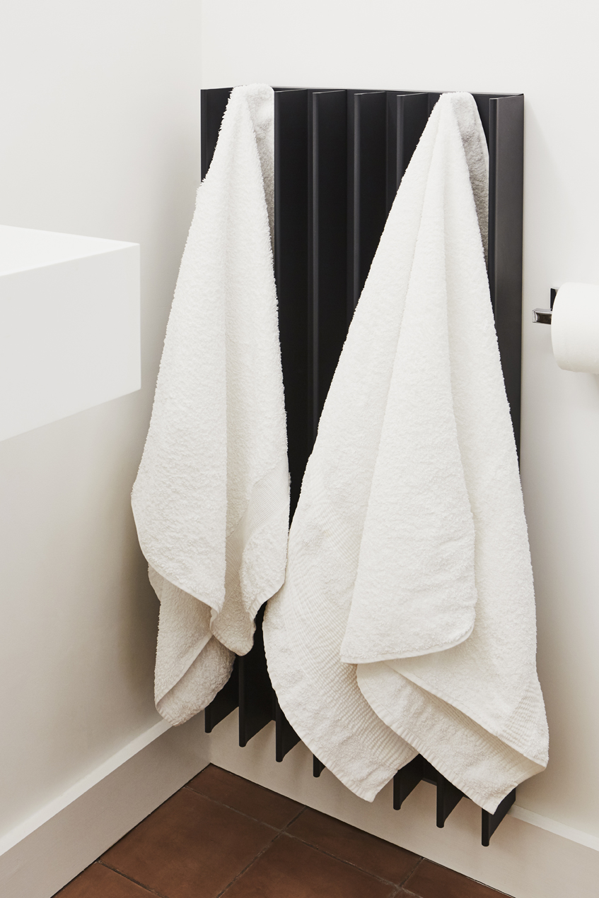 Eskimo heats electric towel rail with towels hanging off it