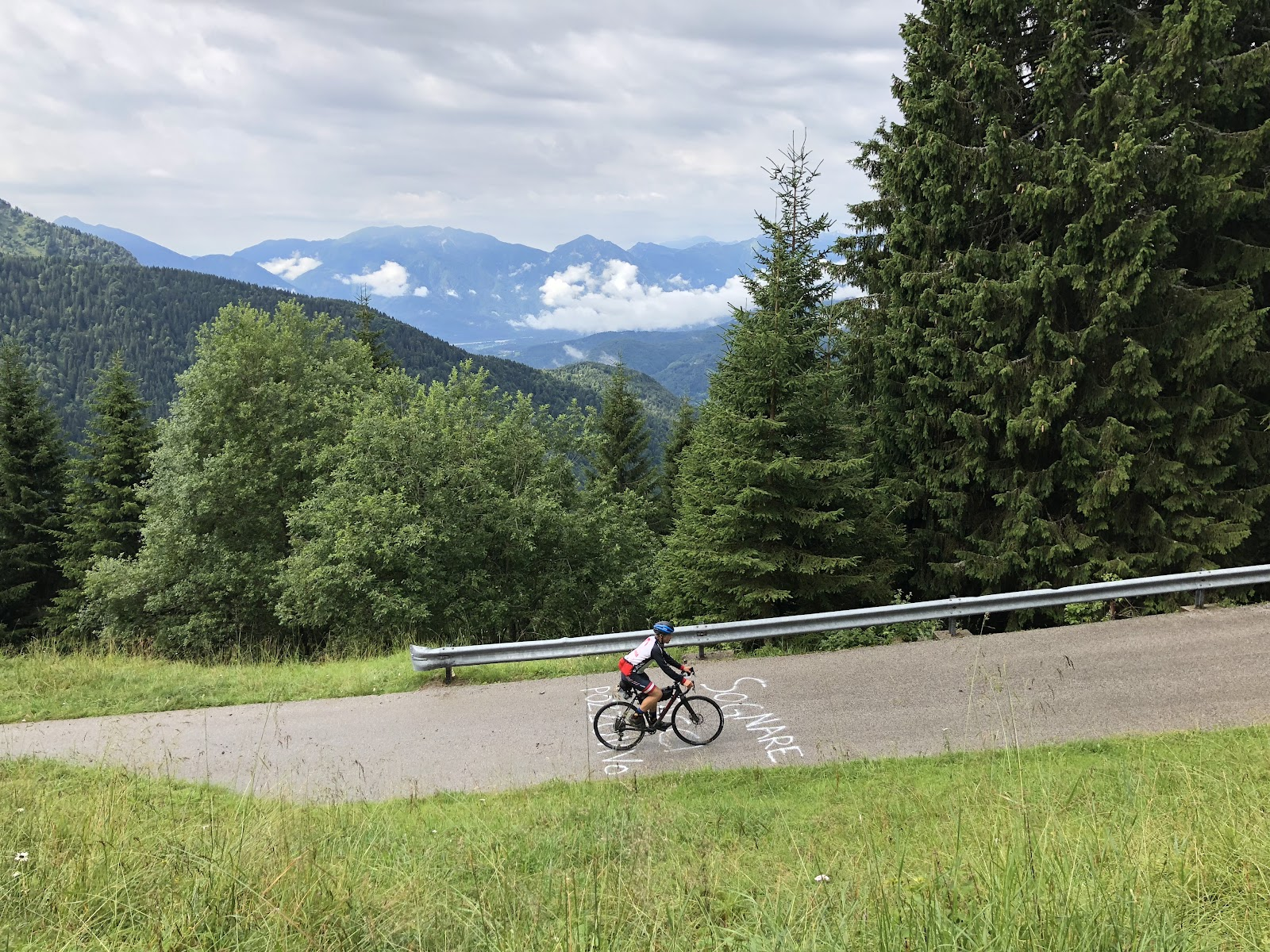 Cycling Monte Zoncolan from Ovaro - cyclist below riding on road over giro d'italia paint