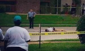Michael Brown lies in street following shooting.