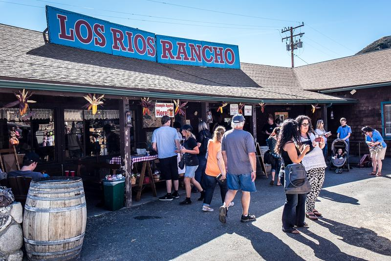 Photo of many people gathered around the general store at Los Rios Rancho.